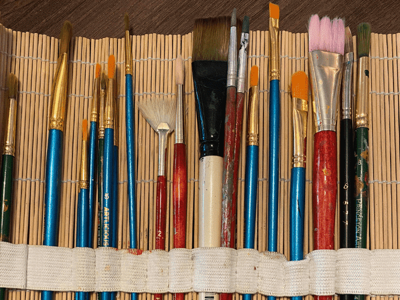 well used collection of paint brushes